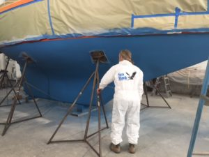 Blue antifouling completed on Puffin's bottom Glenn Sea Hawk logo